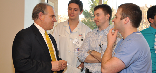 Jeffrey Keller, PhD, left chats with neurosurgical residents