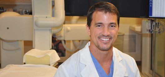 Andrew Ringer, MD, in the angiography suite at University Hospital. Photo by Cindy Starr / Mayfield Clinic.