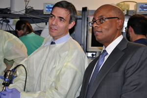 Norberto Andaluz, MD, of the Mayfield Clinic and UC, and Khaled Aziz, MD, of Drexel University and the University of Pittsburgh, in the Department of Otolaryngology's training lab. Photo by Cindy Starr.